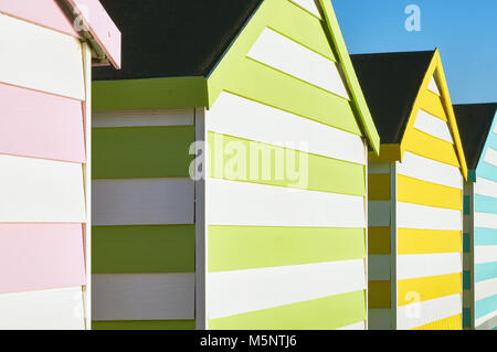 Row of coloured beach huts on the South Coast - Stock Photo
