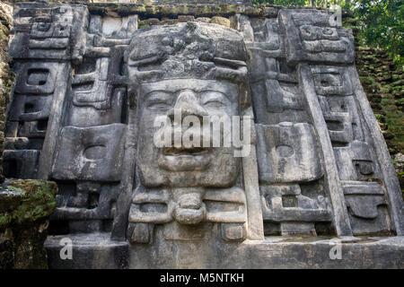 Mask Temple at Belize Lamanai Mayan Ruins - Stock Photo