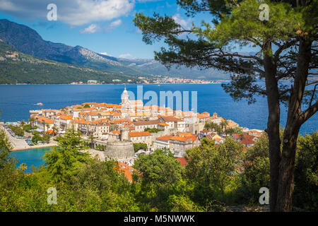 Beautiful view of the historic town of Korcula on a beautiful sunny day with blue sky and clouds in summer, Island - Stock Photo
