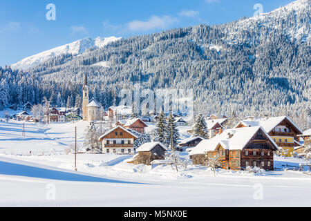 Historic Gosau mountain village in the Alps on a scenic cold sunny day with blue sky and clouds in winter, Salzkammergut, - Stock Photo