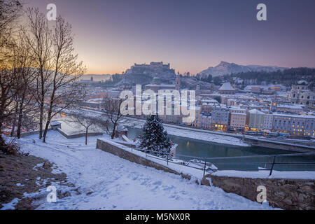 Classic panoramic view of the historic city of Salzburg with Salzach river in beautiful early morning light at sunrise - Stock Photo