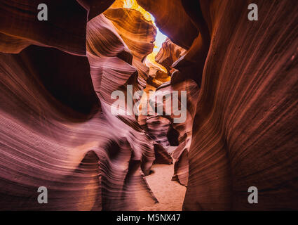 Amazing sandstone formations in famous Antelope Canyon on a sunny day in summer, Page, Arizona, USA - Stock Photo