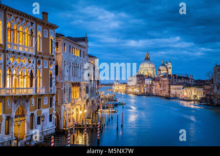Classic view of famous Canal Grande with historic Basilica di Santa Maria della Salute in the background in twilight, - Stock Photo