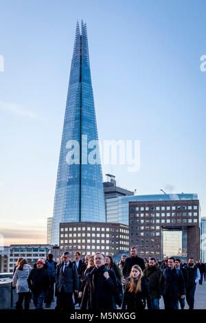 Commuters Walking Across London Bridge On Their Way To Work In The City of London, London, UK - Stock Photo