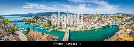 Aerial panoramic view of Zurich city center with famous Fraumunster Church and river Limmat at Lake Zurich from - Stock Photo