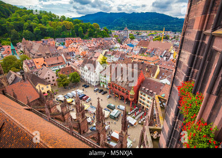 Aerial view of the historic city center of Freiburg im Breisgau from famous Freiburger Minster in beautiful evening - Stock Photo