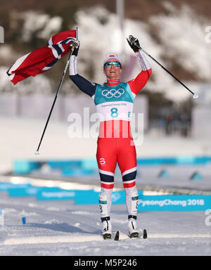 PyeongChang, South Korea. 18th Feb, 2018. Gold medal winner MARIT BJOERGEN of Norway at the finish of Cross-Country - Stock Photo