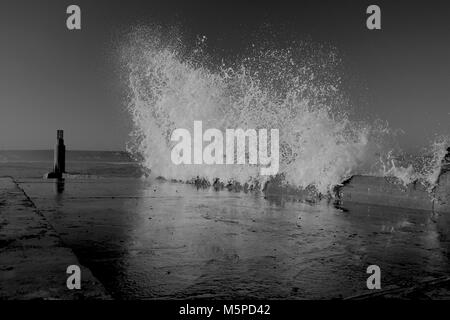 When stormy seas meet land, things happen.... - Stock Photo