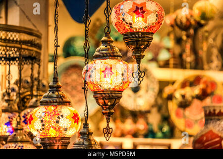 Traditional bright decorative hanging Turkish lights and colourful light lamps with vivid colours  in Turkey Pavilionq - Stock Photo