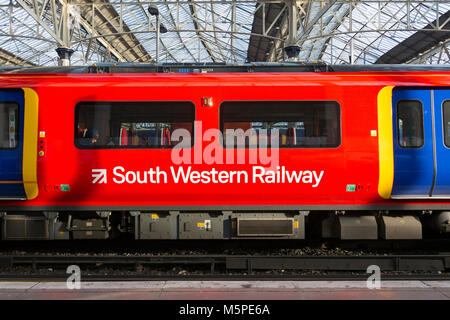 A First Group/MTR South Western Railway Desiro City class 707 train, built by Siemens, waiting at at the station. - Stock Photo