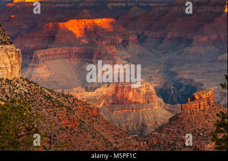 Sunrise at The Grand Canyon, the rising sun picks out interesting rock formations near Yaki Point at The Canyon's - Stock Photo