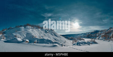 Large snow expanses. The blue sky and the bright sun. Mountains and plains. - Stock Photo