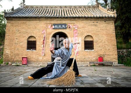 Shaolin monk in training - Stock Photo