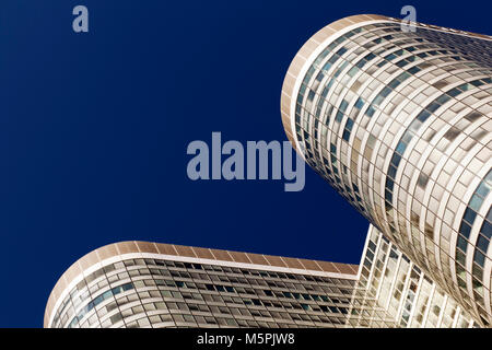 A rare view of curved and geometric modern skyscraper office buildings in Paris, France - Stock Photo