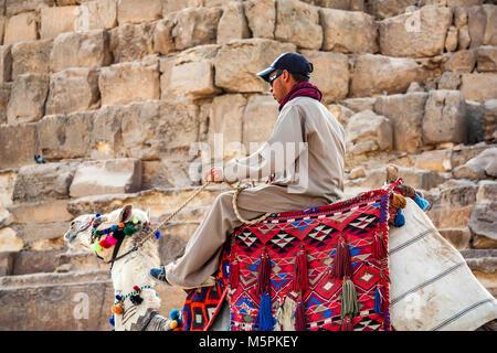 HURGHADA, EGYPT- FEBRUARY 22, 2010: Unidentified camel rider in Egypt - Stock Photo