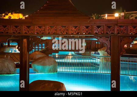 HURGHADA, EGYPT- FEBRUARY 22, 2010: Night view of pool in luxury resort in Egypt - Stock Photo