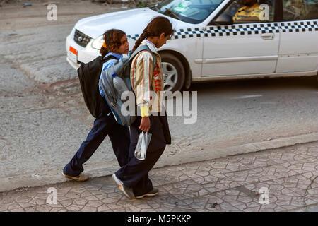 HURGHADA, EGYPT- FEBRUARY 22, 2010: Unidentified egyptian schoolchildren - Stock Photo