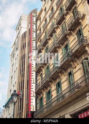 Architecture of Barcelona town with gigant thermometer mounted on a wall of building - Stock Photo