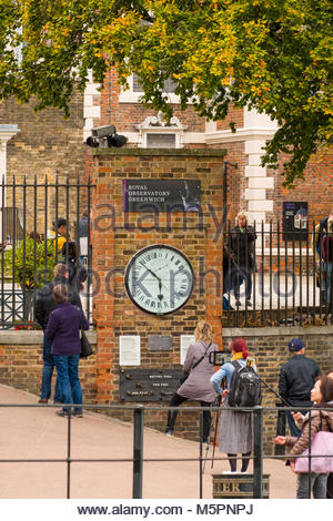 People looking at the Shepherd Gate Clock, The Royal Observatory, Greenwich, London, England, United Kingdom - Stock Photo