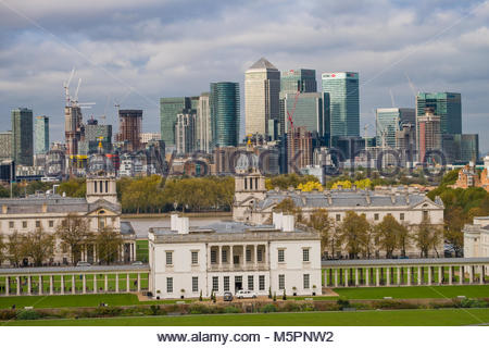 High rise office towers located at Canary Wharf rising above Old Royal Naval College buildings and the Queen's House - Stock Photo