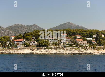 houses by the sea, island of Hvar, Croatia - Stock Photo