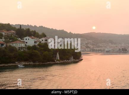 Sunrise in Vela Luka on island Korcula, Croatia. - Stock Photo