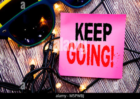 Hand writing text caption showing Keep Going. Business concept for Go Moving Forward Letting written on the wood - Stock Photo