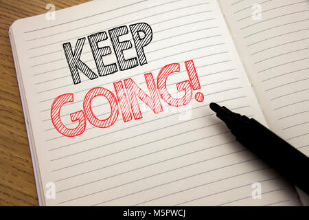 Handwriting Announcement text showing Keep Going. Business concept for Go Moving Forward Letting written on notebook - Stock Photo