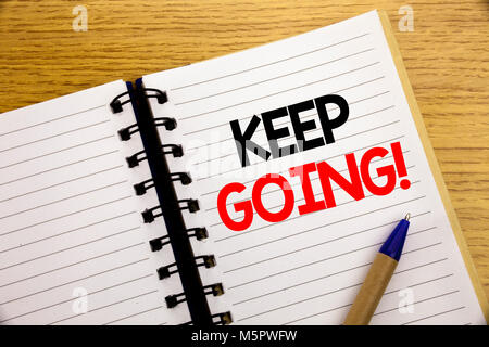 Word, writing Keep Going. Business concept for Go Moving Forward Letting written on notepad with space on old wood - Stock Photo