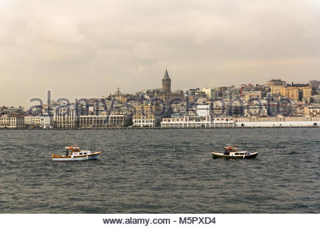 Istanbul, Turkey-December 13, 2015 -Two pleasure boats with crews on board are anchored in the middle of the strait - Stock Photo