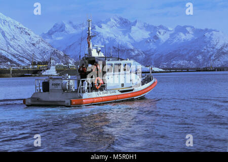Coast Guard members assigned to the U.S. Coast Guard Station Valdez head back to station after recovering hazardous - Stock Photo