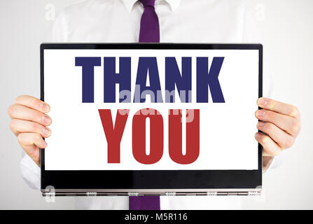 Word, writing Thank You. Business concept for Gratitude Thanks Written on tablet laptop holding by man blurred background. - Stock Photo