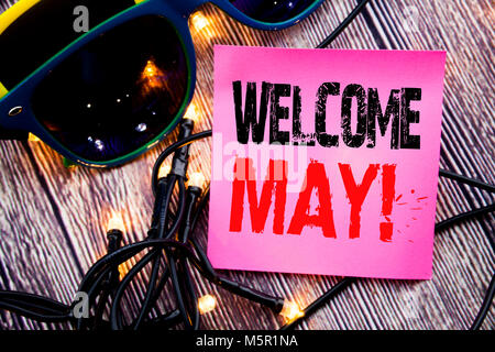 Hand writing text caption showing Welcome May. Business concept for Hello Month Greeting written on the wood with - Stock Photo