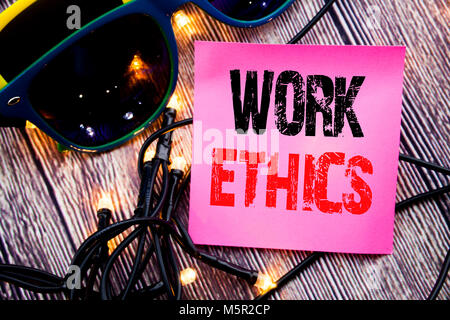 Hand writing text caption showing Work Ethics. Business concept for Moral Benefit Principles written on the wood - Stock Photo