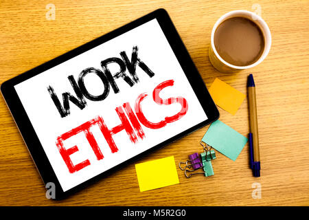 Handwritten text caption showing Work Ethics. Business concept writing for Moral Benefit Principles Written on tablet, - Stock Photo