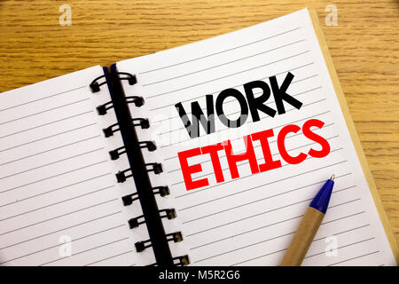 Word, writing Work Ethics. Business concept for Moral Benefit Principles written on notepad with space on old wood - Stock Photo