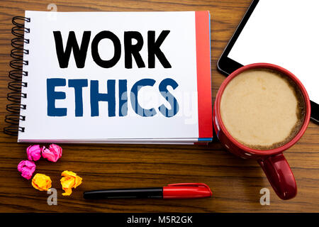 Handwritten text showing Work Ethics. Business concept writing Moral Benefit Principles Written on notepad paper, - Stock Photo