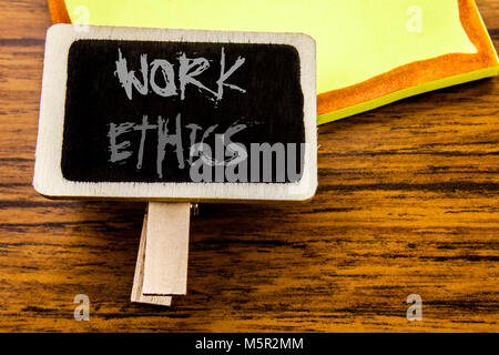 Handwritten text showing Work Ethics. Business concept for Moral Benefit Principles written on announcement board - Stock Photo
