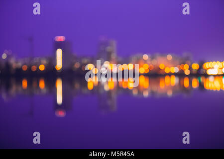 Abstract Blurred Bokeh Architectural Urban Backdrop With Reflections In Water. Real Blurred Colorful Bokeh Background - Stock Photo