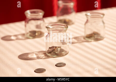 Coins in glass jar. Money savings concept - Stock Photo