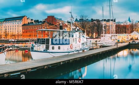 Helsinki, Finland - December 6, 2016: Pleasure Boat In Evening Illumination At The Pier. - Stock Photo