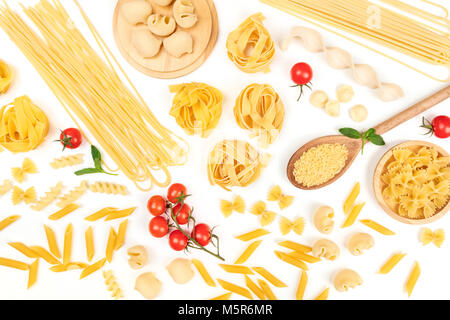 Overhead photo of different types of pasta on white - Stock Photo