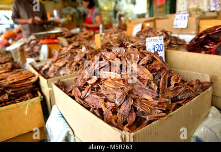 Dry Squid for sale at market in paper box - Stock Photo