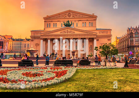 Moscow, Russian Federation - August 27, 2017 : Summer sunset at Bolshoi Theatre wih tourists and residents enjoy - Stock Photo