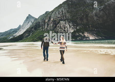 Romantic Couple in love walking holding hands on beach sea man and woman together traveling Lifestyle concept vacations - Stock Photo