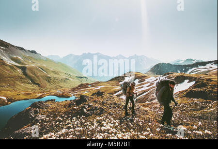Couple backpackers hiking together in mountains adventure travel lifestyle wanderlust concept active vacations outdoor - Stock Photo