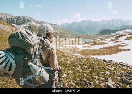 Backpacker tourist hiking in mountains adventure travel lifestyle concept active summer vacations sport outdoor - Stock Photo