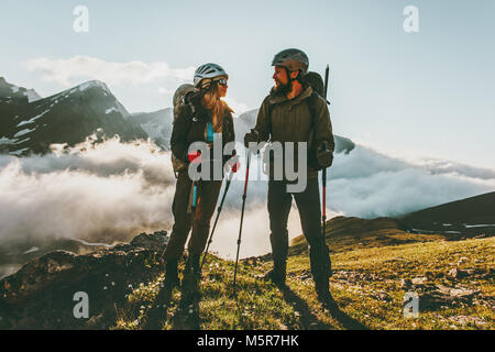 Travel Couple backpackers man and woman hiking in mountains love and adventure Lifestyle wanderlust concept - Stock Photo