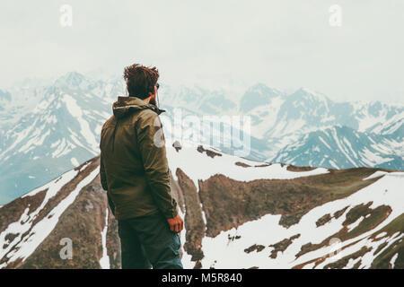 Man traveler alone wander mountains landscape Travel Lifestyle concept adventure outdoor active vacations trekking - Stock Photo