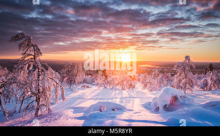 Panoramic view of beautiful winter wonderland scenery in scenic golden evening light at sunset with clouds in Scandinavia, - Stock Photo